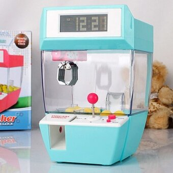 The new mini children grasping doll machine electronic game clock clock creative lazy students quiet bedside
