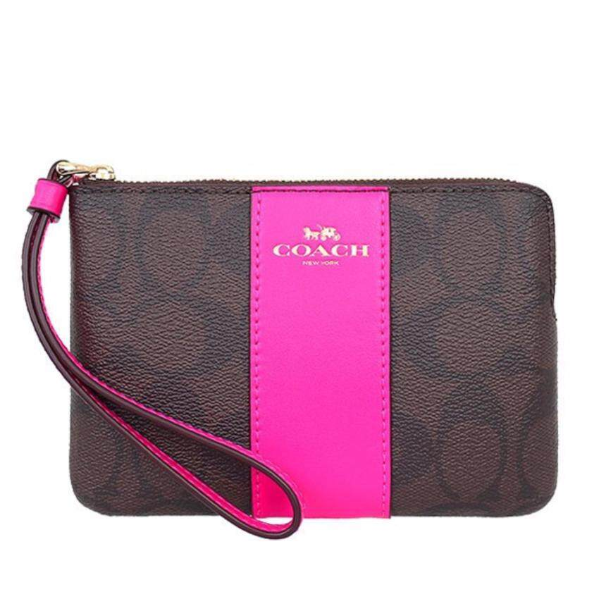 COACH กระเป๋า CORNER ZIP WRISTLET IN SIGNATURE COATED CANVAS WITH LEATHER STRIPE F58035 IMMJJ (IM/Brown Bright Fuchsia)